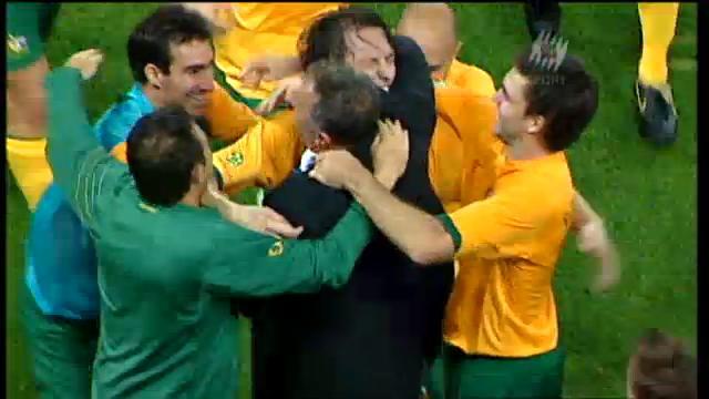 Popovic, Arnold embrace