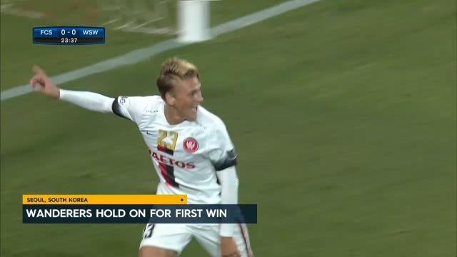 Wanderers hold on for 1st win