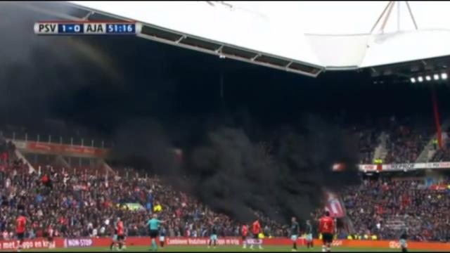 Smoke bomb halts PSV victory