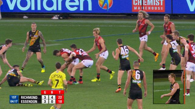 Bomber tackles teammate